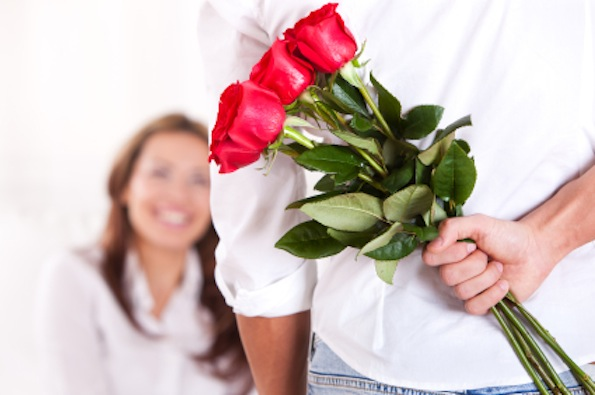 guy giving flowers to girl