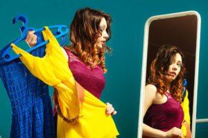 Woman-preparing-to-party-trying-dress-choosing-clothing
